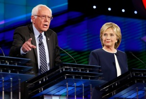 Hillary Rodham Clinton, right, looks on as Sen. Bernie Sanders, of Vermont, speaks during the CNN Democratic presidential debate Tuesday, Oct. 13, 2015, in Las Vegas. (AP Photo/John Locher) ORG XMIT: NVCC237